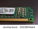 Close up macro shot of Kingston RAM memory module with pins against dark background