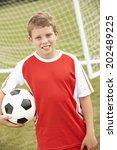 portrait boy in soccer kit with ... | Shutterstock . vector #202489225