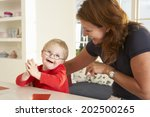 downs syndrome boy having... | Shutterstock . vector #202500265