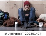 Homeless Young Man Living On...