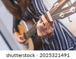 playing guitar. woman playing...   Shutterstock . vector #2025321491