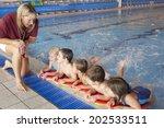 children having swimming lesson | Shutterstock . vector #202533511