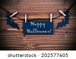happy halloween written on a... | Shutterstock . vector #202577605