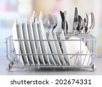 clean dishes drying on metal... | Shutterstock . vector #202674331