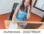 businesswoman is on her cell...   Shutterstock . vector #2026798634