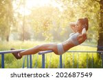 beautiful fitness woman doing... | Shutterstock . vector #202687549