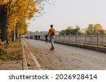 Man On Skateboard On Autumn...