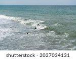 The Sea Wave Foams At The Edge...