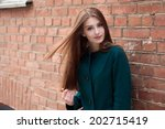 young elegant woman in front of ... | Shutterstock . vector #202715419
