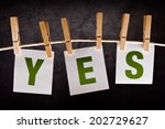 Small photo of Yes, concept of acceptance and approval. Letters are printed on notes paper and attached to rope with clothes pins.