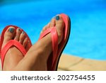 Female Feet By The Poolside...