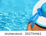 young lady with white blue hat... | Shutterstock . vector #202754461