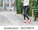 woman wearing black leather... | Shutterstock . vector #202758574