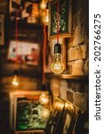 lighted bulbs and pictures on a ... | Shutterstock . vector #202766275