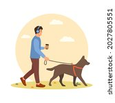 a young man walks the dog.... | Shutterstock .eps vector #2027805551