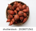 Small photo of fresh Salak Palm , waive ,or (Salacca zalacca) fruit in wooden basket isolate on white background