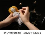 Woman Stabbing Voodoo Doll With ...