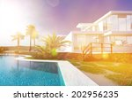luxury modern white house with...   Shutterstock . vector #202956235