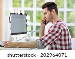 young man working on computer... | Shutterstock . vector #202964071