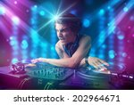 young dj mixing music in a club ...   Shutterstock . vector #202964671