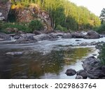 A Stormy River Among Rocks And...