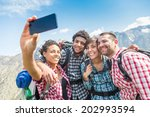 Friends Taking Selfie At Top O...