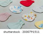 Small photo of Baby sock. View from top left. Wide selection of baby socks. Warm baby clothes. Multi-colored socks for girls and boys. Socks scattered on the table. Clothing for kids.