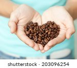 Coffee Beans In Human Hands  I...