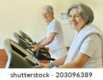 Senior Couple In Gym On Runnin...