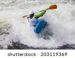 An Active Male Kayaker Rolling...