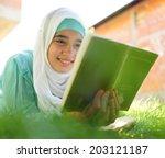 Beautiful Muslim Girl Reading...