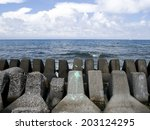 Tetrapode at the coastline of the island of SiaoLiuQui, Taiwan. - stock photo