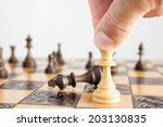 photographed on a chess board | Shutterstock . vector #203130835