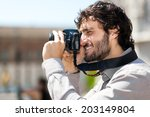 male tourist taking picture in... | Shutterstock . vector #203149804