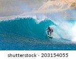 surfing a wave. lombok island.... | Shutterstock . vector #203154055