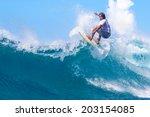 surfing a wave. lombok island.... | Shutterstock . vector #203154085
