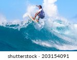 surfing a wave. lombok island.... | Shutterstock . vector #203154091