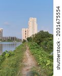 Small photo of Cluster of large residential skyscraper near the edge of a fishery at East Kolkata Wetlands. The entire area is surrounded by lush greenery and sewage fed fisheries making a unique natural habitat.