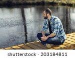Man Meditating On The Bank Of ...