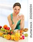 young woman having breakfast.... | Shutterstock . vector #203200054