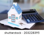 toy house and calculator on... | Shutterstock . vector #203228395