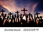 Group Of People Holding Cross...