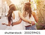 boho girls walking in the city  | Shutterstock . vector #203259421