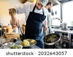 chef cooking spagetti in the... | Shutterstock . vector #2032643057
