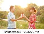 valentine gift. happy couple in ... | Shutterstock . vector #203292745