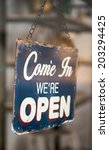 come in we are open sign on a... | Shutterstock . vector #203294425