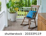 Wooden Rocking Chair On Front...