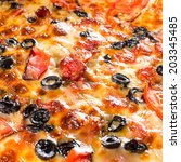 Appetizing background pizza closeup filling the frame. - stock photo