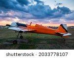 Orange Sports Airplane Parked...