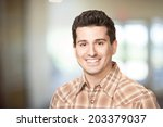 handsome smiling young man... | Shutterstock . vector #203379037